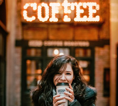Octovid-Shopify-app-photo-of-woman-wearing-black-leather-jacket-holding-a-coffee-how-to-video-ad-creator